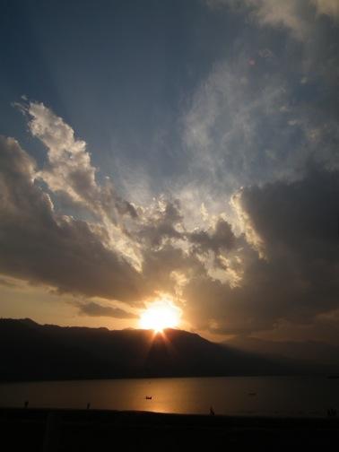 Sunset behind Phewa Lake in Pokhara, Nepal