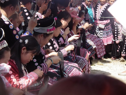 Women, both young and old, take part in a sewing and embroidery competition during the Hmong New Year celebration.