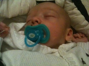 Akiva with a pacifier or dummy
