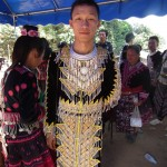 A young Hmong man with an eye-catching outfit.