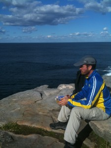 Rabbi Ben meditating as he looks out over the Pacific Ocean