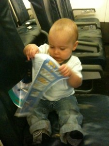 Akiva as he sat on one of our many flights last year, reading the safety information card